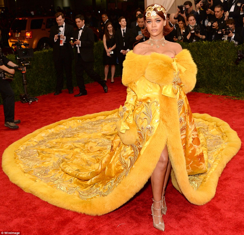 Rihanna goes for detail and volume in a yellow gown by Chinese couture designer Guo Pei.