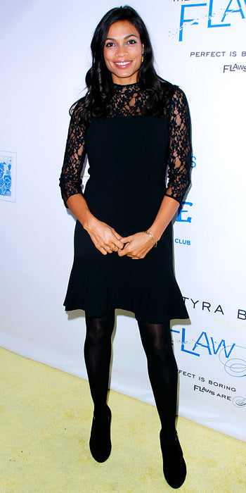 Rosario Dawson was demure in black lace at a charity evemt
