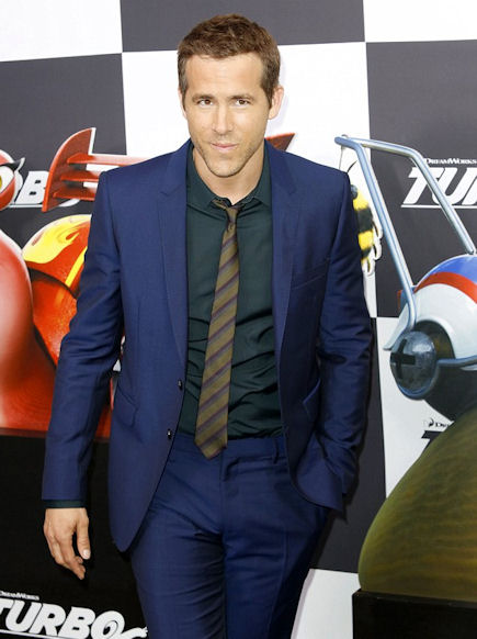 Ryan Reynolds attended the premiere in a navy suit and striped tie