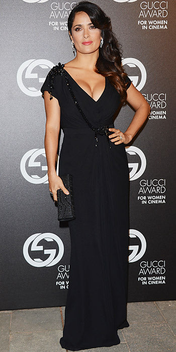 Salma Hayek Pinault poured her curves into a black Gucci gown during an event at the Venice Film Festival