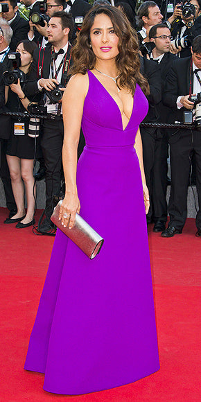 Salma Hayek in a gorgeous purple Gucci gown with plunging neckline.