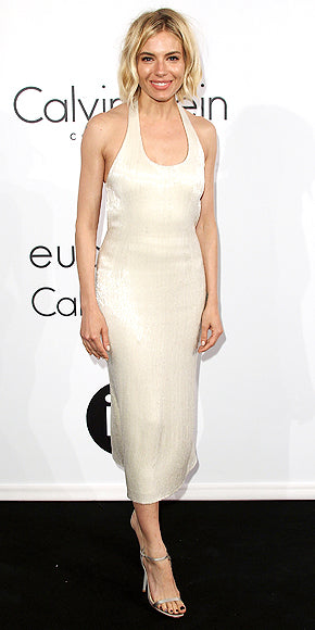 Sienna Miller was anything but simple in this champagne colored Calvin Klein Collection dress.