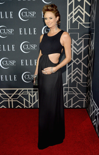 Stacy Keibler showed off her mommy-to-be body in a cut out black dress.