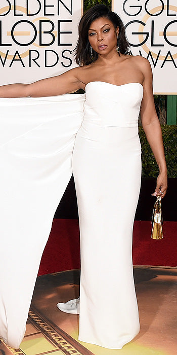 Taraji P. Henson was on trend in a caped white column gown. (Photo by Jason Merritt/Getty Images)