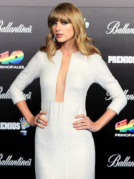 Taylor Swift wears her sheer in front, sporting a super chic metallic sheath