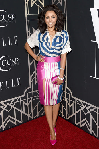 Vampire Diaries star Kat Graham went for a bold skirt and blouse combo.
