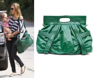Jessica Alba is surrounded by adorable baby Honor and a stylish oversized green bag