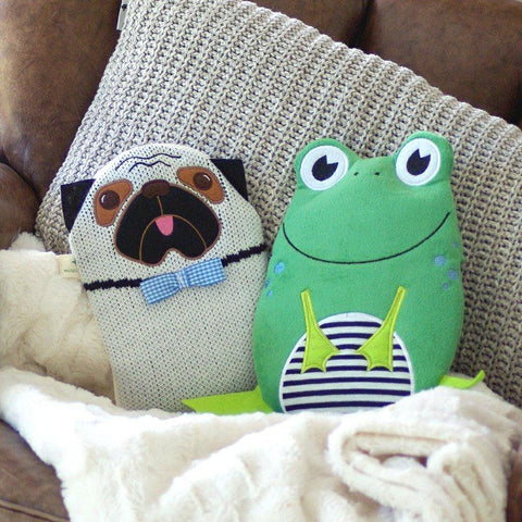 Pug and Frog Eco-Sustainable Hot Water Bottle over beige designer cushion