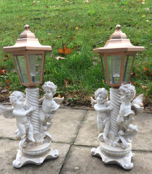 SET OF 2 SOLAR CHERUBS ON POST