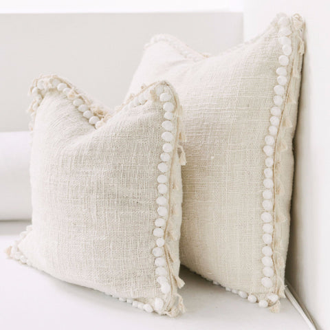 cream cotton and shell cushion