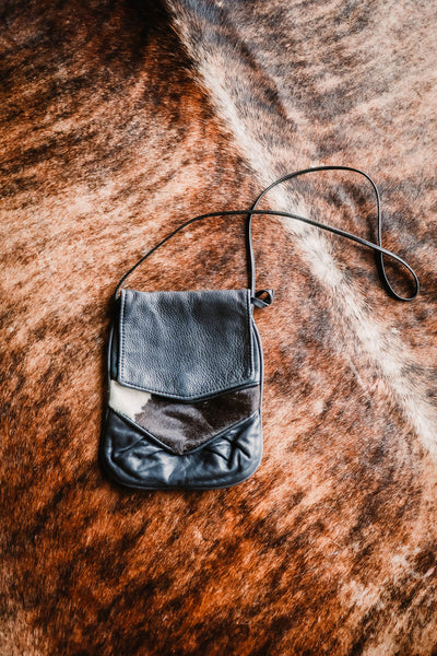 vintage cowhide and black leather purse