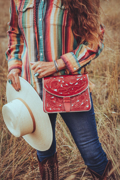 vintage red leather tooled western purse.