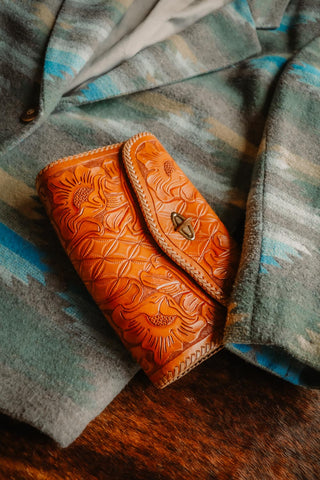 vintage tooled western leather clutch