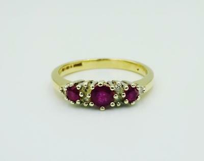 9ct Yellow Gold Ladies Ruby Cluster Diamond 0.10ct Three Stone Ring 15mm 2.76g O