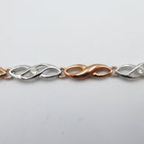 9ct 2 Colour White Rose Gold 0.16ct Diamond Infinity Ladies Bracelet 8.25inch 5g - Richard Miles Jewellers