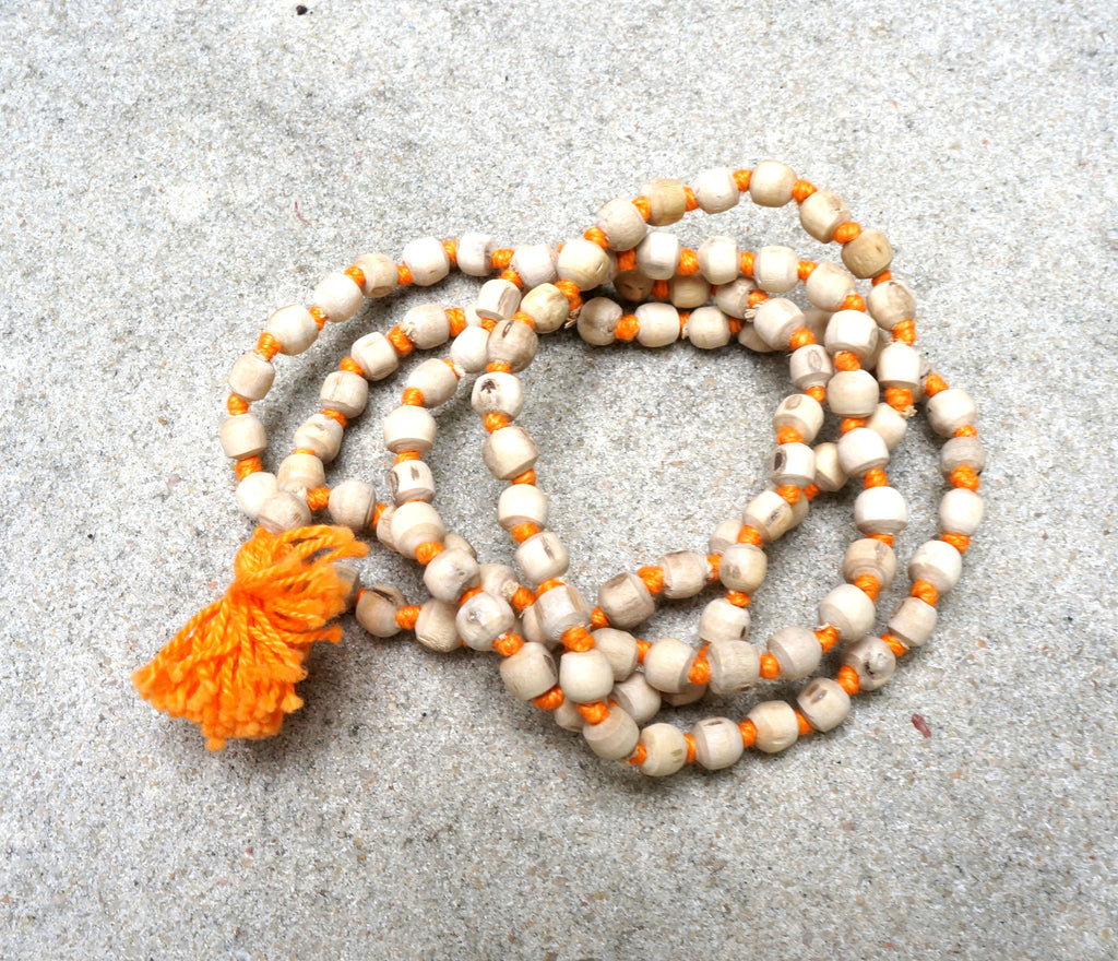 WOOD BEAD MALA NECKLACE - are treasured for their rarity.