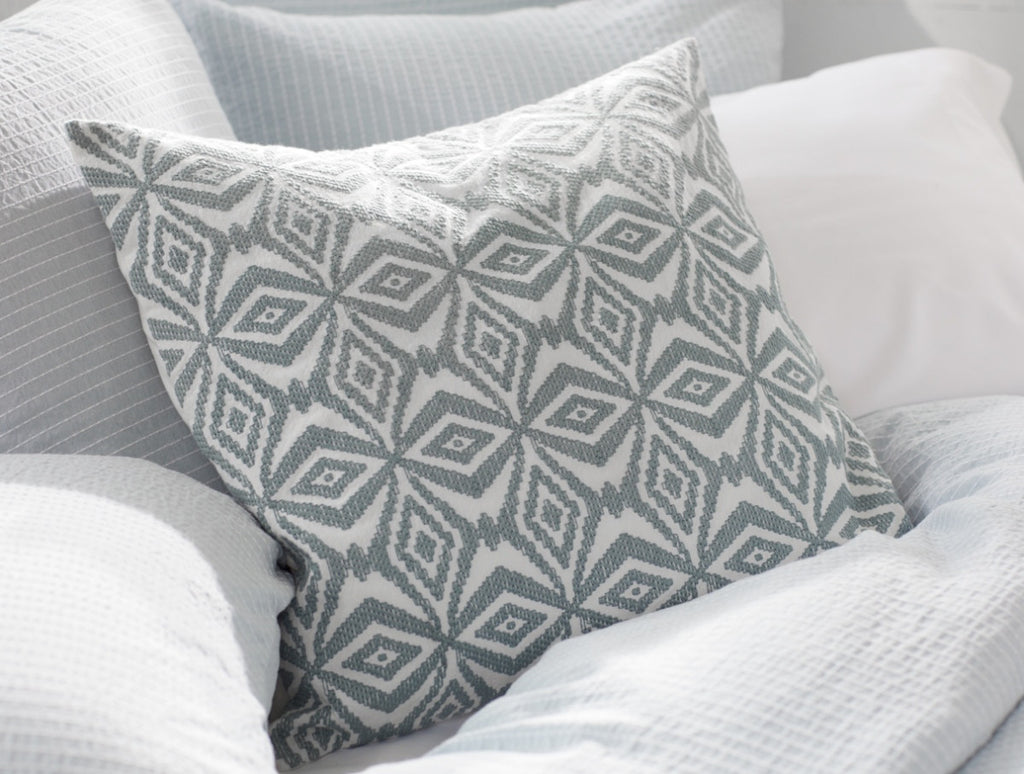 Kaleidoscope Embroidered Pillow. are embroidered on our organic cotton pillow