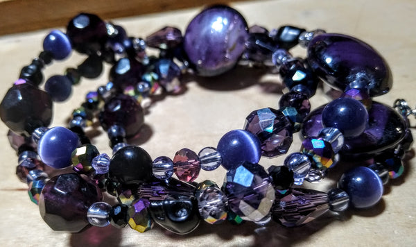 Spectrum of Purple and Rainbow: Lampwork and Crystal Gothic Bracelet With Black Skulls