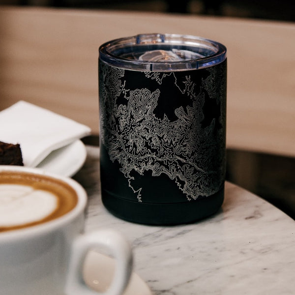 10oz Stainless Steel Insulated Cup in Black with Custom Engraved Map on Table next to Coffee Cup