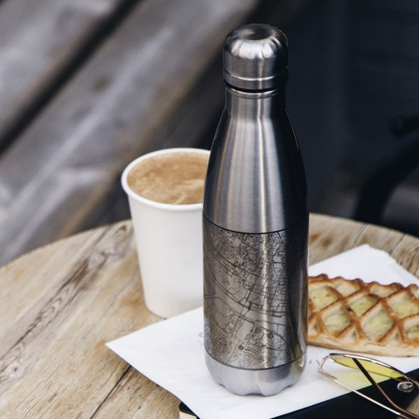 17oz Stainless Steel Insulated Cola Bottle with Custom Engraved Map on Table with Pastry and Sunglasses