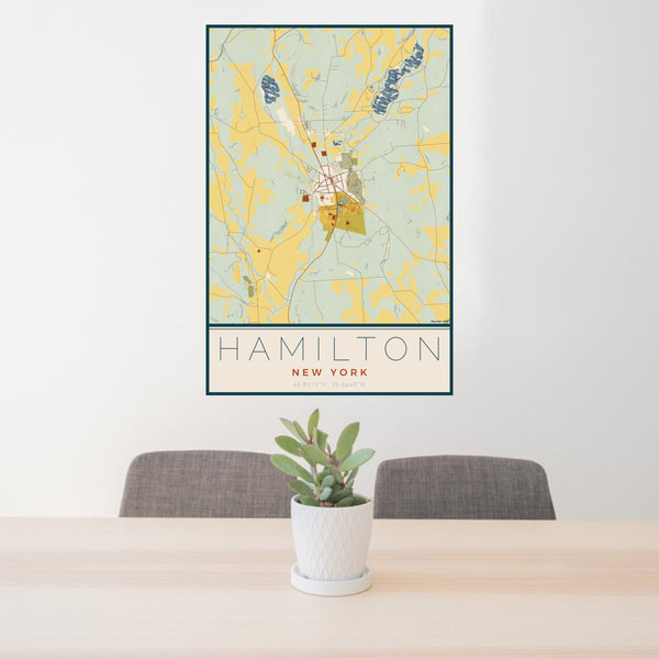 24x36 Hamilton New York Map Print Portrait Orientation in Woodblock Style Behind 2 Chairs Table and Potted Plant