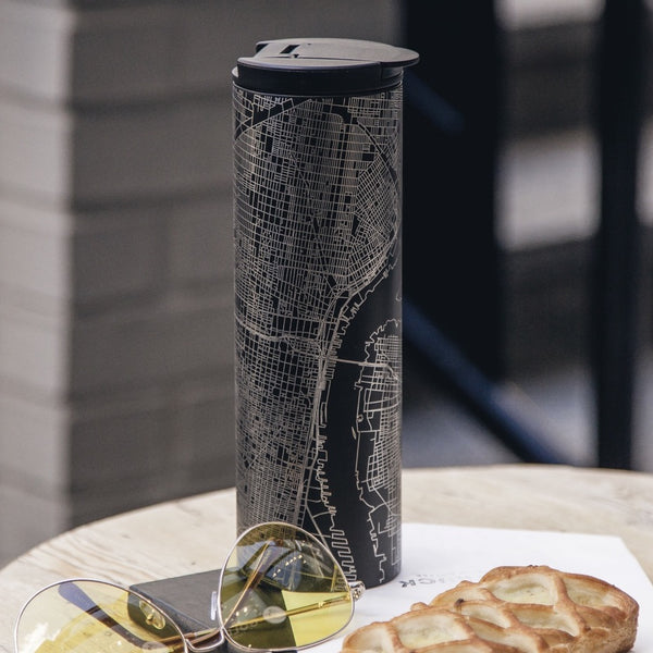 17oz Stainless Steel Insulated Tumbler in Black with Custom Engraving of Map on Table Next to Sunglasses and Pastry