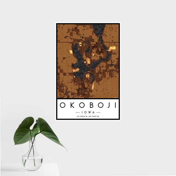 16x24 Okoboji Iowa Map Print Portrait Orientation in Ember Style With Tropical Plant Leaves in Water
