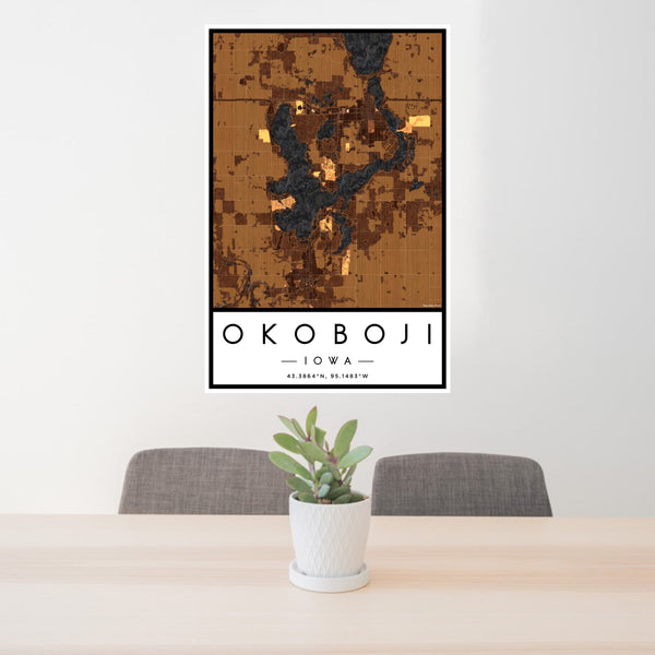 24x36 Okoboji Iowa Map Print Portrait Orientation in Ember Style Behind 2 Chairs Table and Potted Plant