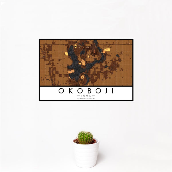 12x18 Okoboji Iowa Map Print Landscape Orientation in Ember Style With Small Cactus Plant in White Planter