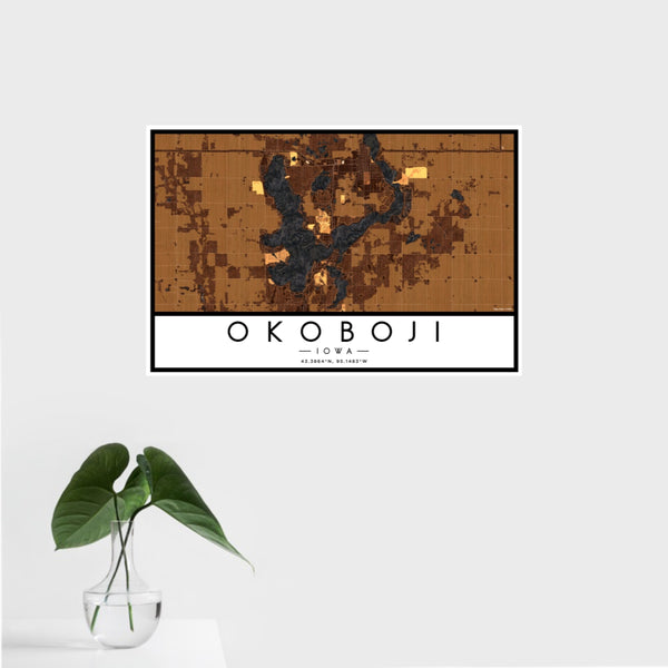 16x24 Okoboji Iowa Map Print Landscape Orientation in Ember Style With Tropical Plant Leaves in Water