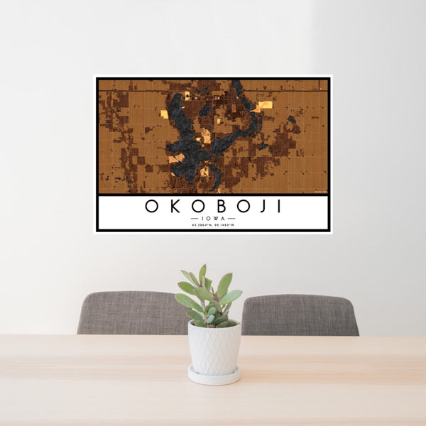 24x36 Okoboji Iowa Map Print Landscape Orientation in Ember Style Behind 2 Chairs Table and Potted Plant