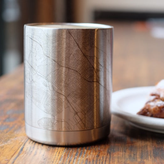 10oz Stainless Steel Insulated Cup with Custom Engraved Map on Table next to Pastry