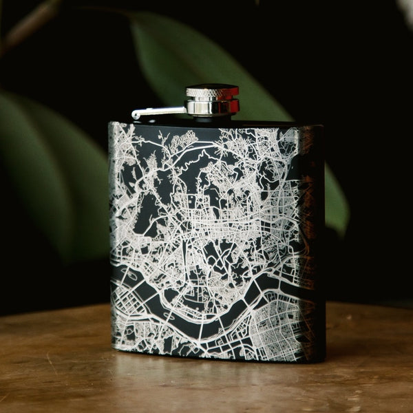 6oz Stainless Steel Flask in Black with Custom Engraved Map on Table