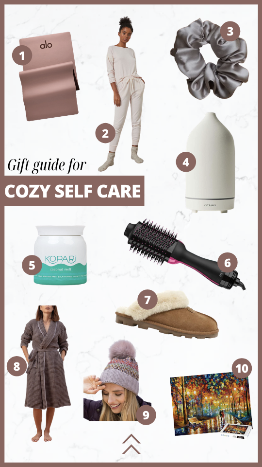 Gift guide for cozy self care. Alo yoga mat, sleep set, Silk Labs srunchie, Diffuser, Kopari Coconut Melt, Revlon hair dryer, Loomia robe, Kyi Kyi faux fur beanie, puzzle.