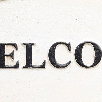 Oval Metal Wall Sign with Welcome Typography White and Black By Casagear Home BM229313