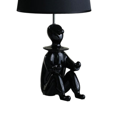 Fabric Shade Table Lamp with Polyresin Sitting Clown Base Black By Casagear Home BM231811