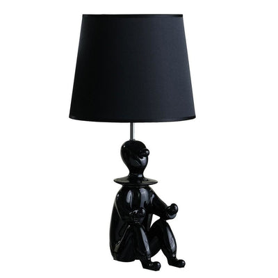 Fabric Shade Table Lamp with Polyresin Sitting Clown Base, Black By Casagear Home