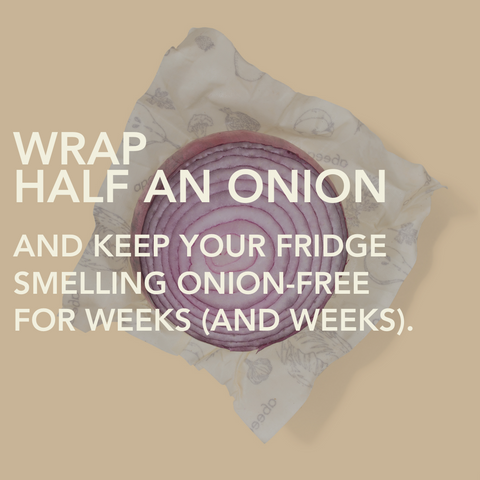 Image of half a red onion sitting on top of an Abeego beeswax food wrap