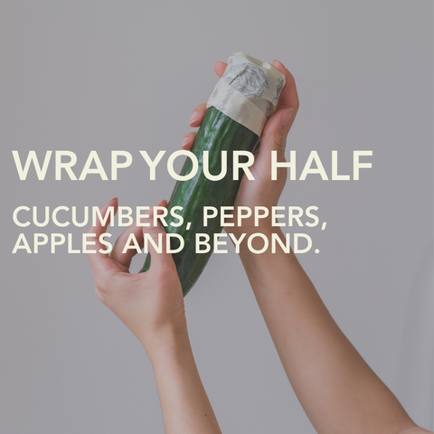 Hands holding up half a cucumber with the end wrapped in a small Abeego Beeswax Food Wrap