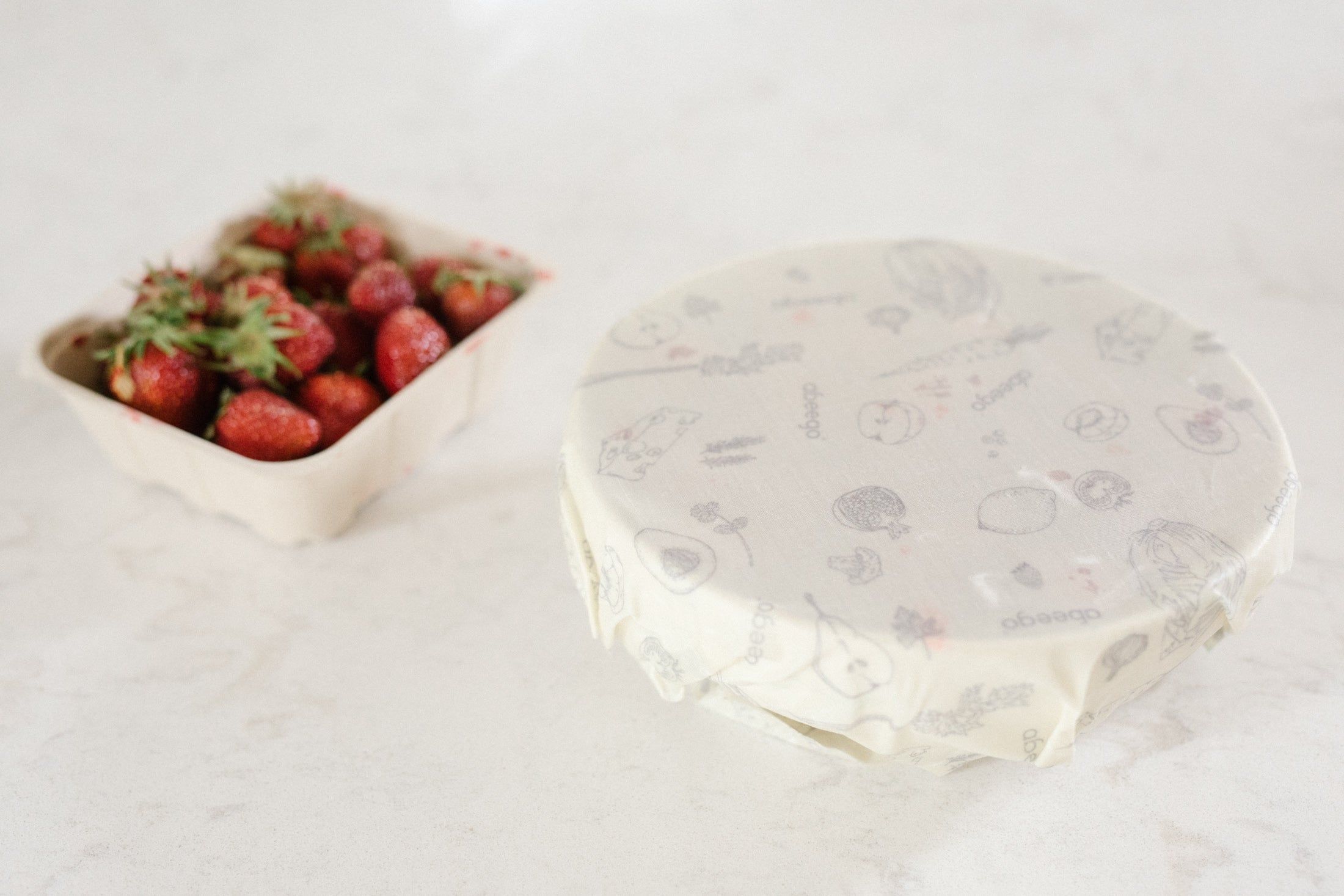 Cover a bowl with Abeego wraps to keep strawberries fresh