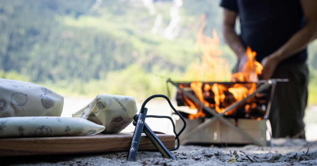 Wolf and Grizzly Fire Set and Abeego-wrapped food in foreground with fire blazing in background