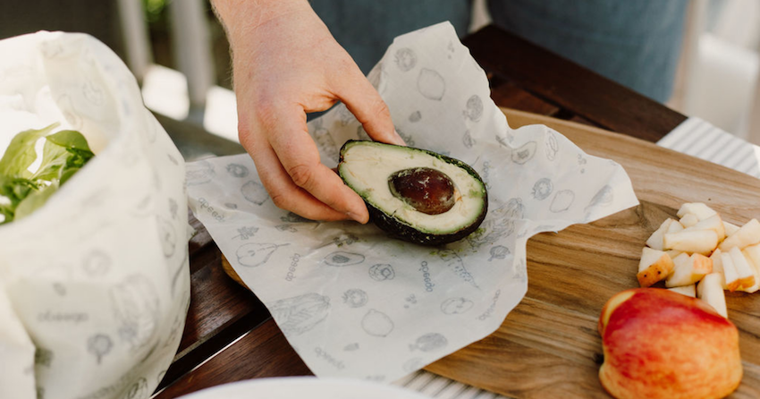 halved avocado being wrapped in Abeego