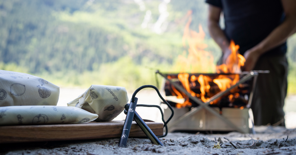 Abeego wrapped food next to the wolf & grizzly firestarter outdoors. Fire in background.