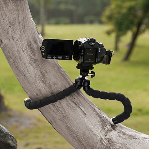 mini octopus tripod holds digicam on a branch