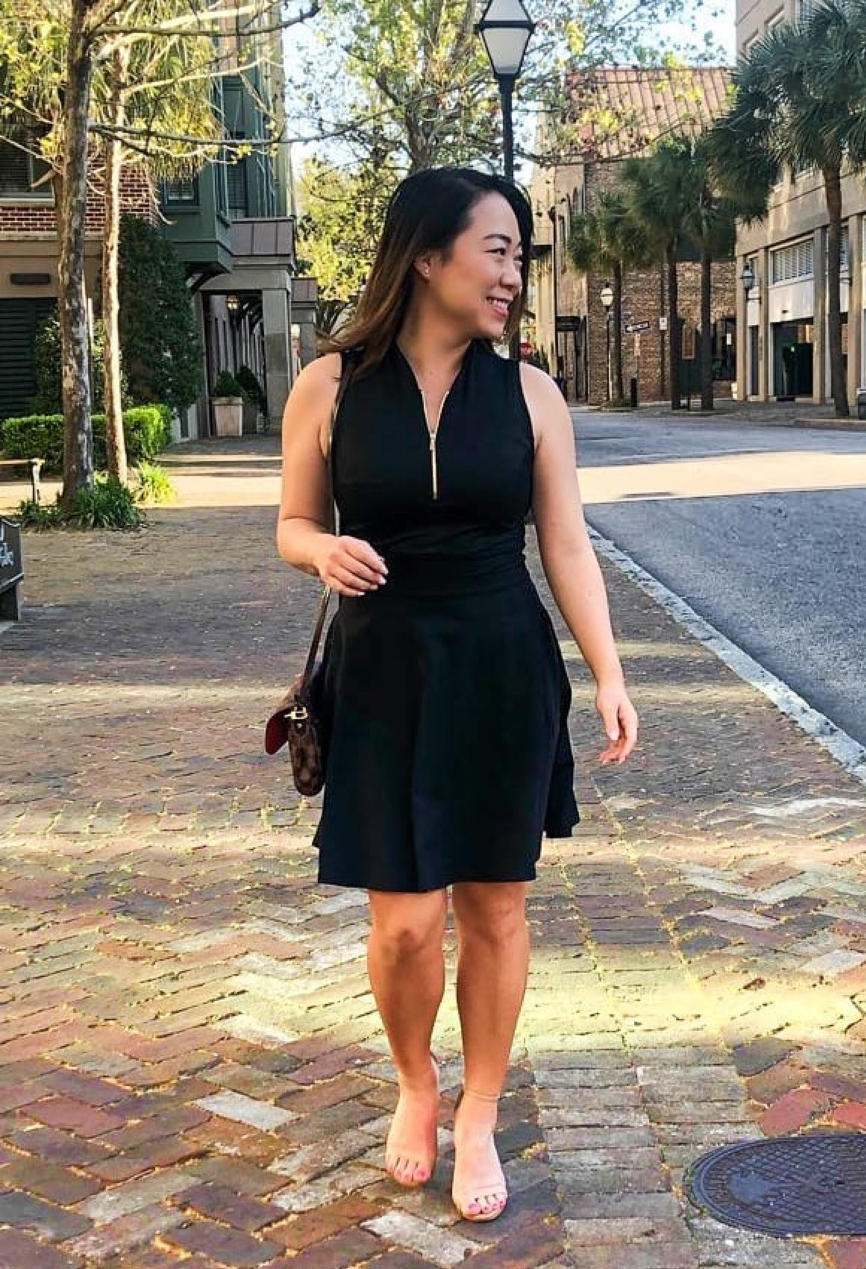 Cathy Kim wearing Amy Sport Fit and Flare dress in black.