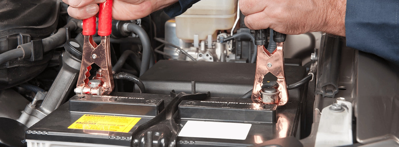 placing jumper cables on car battery
