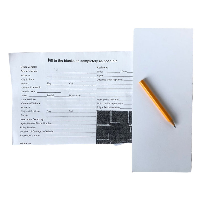 Fill in the blank car accident report and a blank pad of paper with pencil for recording an car accident