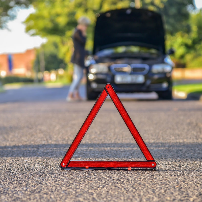 reflective safety triangle on roadside
