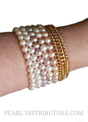 Jewelry Trend Spring/Summer 2014 Stacked Bracelets... try it with Pearl Bracelets