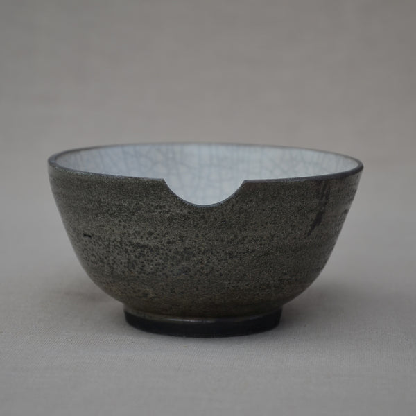 Small bellied and altered Raku bowl